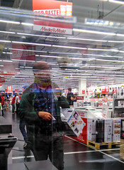Electronic shopping (A. Yousuf Kurniawan) Tags: mall shopping people abstract streetlife streetphotography phonestreet cameraphone colourstreetphotography