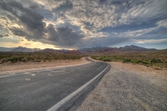 Calico Road (magnetic_red) Tags: road twisted curves sunset clouds horizon storm redrockcanyon blm publiclands