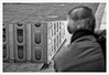Fotografia riflessiva (Outlaw Pete 65) Tags: ritratti portraits persone people fotografo photographer riflessi reflections pozzanghera puddle edificio building finestre windows strada street biancoenero2black and whitefuji xe2fujinon 55200mm brescia lombardia italia