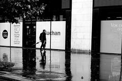 After the downpour (pascalcolin1) Tags: paris13 homme man pluie rain reflets reflection parapluie umbrella lumière light ombre shadow photoderue streetview urbanarte noiretblanc blackandwhite photopascalcolin