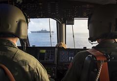 The crew of Landing Craft approaches USS Bonhomme Richard.