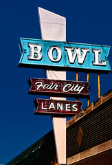 Our Fair City (Marion Brite) Tags: southdakota bowling lanes balls pins blue sky red neon sign small town city outdoors