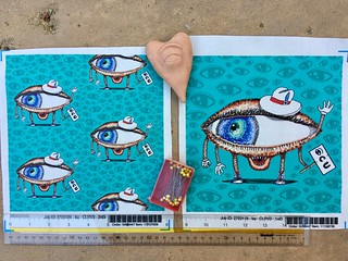 Pointillism Eye Guy, large & small scale fabric test swatches. My original design. Fabric, wallpaper, gift wrap. https://www.spoonflower.com/profiles/amy_g?sort=new