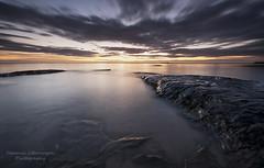Reaching out (Elidor.) Tags: sunrise dawn morning bamburgh beach northumberland hitech d90 rocks