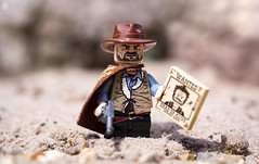 The Mysterious Stranger (Jezbags) Tags: lego legos toys toy minifigure minifigures macro macrophotography macrodreams macrolego canon60d canon 60d 100mm closeup upclose mysterious stranger good cowboy reward wanted sand rock gun