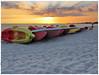 sunset on the beach (kurtwolf303) Tags: sunset sundown sonnenuntergang beach strand boats boote sun sky sonne himmel wolken clouds people sand water wasser orange canon kurtwolf303 compactcamera unlimitedphotos cuba kuba beachscape seascape topf25 topf50 250v10f 500v20f 750views topf75 topf100 karibik caribbean 800views 900views 1000v40f topf150 1500v60f coucherdusoleil