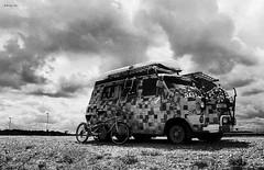 Holiday Bus (MartPics1968) Tags: nikonfe nikkor28mmf28ai blackwhite beach minster isleofsheppey kent ford fordtransit bicycle tamdem sky clouds film fomapan100 kodakd76