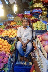 Fruit seller, Crawford Market, Mumbai (Yekkes) Tags: asia india mumbai bombay market crawfordmarket fruit colours hat man barefoot stall salesman merchant sitting