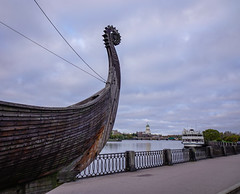 Drakkar (Viking wooden boat) on the waterfront (phuong.sg@gmail.com) Tags: ancient black blue boat carving castle color craft cultural day dragon drakkar europe head historical history horizon lake landscape longship medieval military monster morning nautical nordic north norway old park part river russia sail scandinavian scene sculpture shield ship sky sunny swedish transport travel vessel view viking vyborg warship winter wood wooden