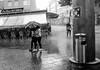 Thunderstorm (A. Yousuf Kurniawan) Tags: rain hardrain storm thunderstorm umbrella water streetlife streetphotography streetphoto urbanlife people cameraphone cameraphonestreet phonestreet blackandwhite monochrome summer weather decisivemoment