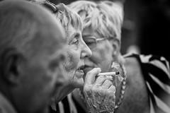 Tete-a-tete (Frank Fullard) Tags: frankfullard fullard confidence monochrome blackandwhite smoke cigarette conversation wrinkles candid street portrait talk listen teteatete dof depthoffield| bokeh gossip natter