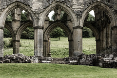 Arches (The Frustrated Photog (Anthony) ADPphotography) Tags: architecture category decay england external northyorkshire places rievaulxabbey travel yorkshire architecturephotography gothic gothicarchitecture travelphotography arch arches stone stonework abbey monastery placeofworship nave grass valley bank hillside trees historic english british greatbritain britain uk unitedkingdom canon1585mm canon canon550d outdoor building structure dissolution cistercianabbey