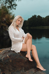 (Øyvind Bjerkholt (Thanks for 69 million+ views)) Tags: overcast lake rocks water cardigan legs blonde beautiful gorgeous sexy sensual sitting pose woman girl female she outdoors canon dof fashion glamour beauty portrait elegance feminine classy landscape nature arendal norway