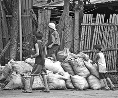 Sacks (Beegee49) Tags: sand bags sacks street climbing playing bacolod city philippines boys