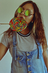 Lollipop (TheJennire) Tags: photography fotografia foto photo canon camera camara colours colores cores light luz young tumblr indie teen people portrait makeup sunglasses curlyhair overalls self 2015 candy naturallight hair blue