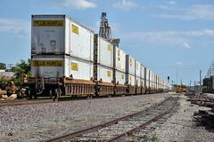 Solid wall of Jb Hunt. (Machme92) Tags: bnsf burligrton bn stacks railroad railfanning railroads railfans rails rail missouri jb jbhunt hunt trucks sky nikon movingamerica