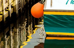 Marina Reflections (Karen_Chappell) Tags: boat buoy orange reflections green yellow ripples abstract stjohns harbour wharf dock pier paint painted canada atlanticcanada atlantic eastcoast newfoundland nfld multicoloured colourful colours fortamherst fishingboat