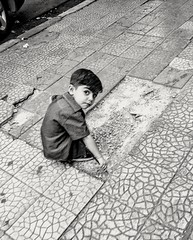 Children can find fun in any thing (DanaKhoudari) Tags: blackandwhite black white monochrome street arab
