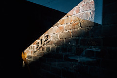 It's A Tragic Divide (davelawrence8) Tags: 2016 annarbor canoneosm contrast light michigan shadow usa brick window