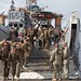 U.S. Marines exit a U.S. Navy landing craft in Puerto Rico.
