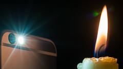 The evolution of lighting up the dark (HMM !) (ralfkai41) Tags: handy candle mobilephone lighting macromondays ilumating macro licht flamme erleuchten makro kerze light evolution fortschritt