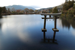 Kinrin lake (Elios.k) Tags: horizontal outdoors nopeople lake water serene reflection valley mountains distance background toriigate inthewater shinto tnsoshrine kinrin longexposure onses trees colour color winter travel travelling december 2016 vacation canon 5dmkii camera photography oitaprefecture yufuin spatown resort onsen kyushu island japan asia