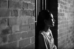 期 盼 (Wilson Au | 一期一会) Tags: hongkong night portrait canon ef50mmf12lusm eos5dmarkiii flash brick street blackandwhite monochrome girl lady wall contrast
