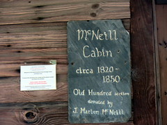 McNeill Cabin Sign. (dccradio) Tags: laurinburg nc northcarolina scotlandcounty northcarolinaruralheritagecenter johnbluehouse heritagevillage history historical museum outdoors outside cabin homestead home building wood wooden canon powershot elph 520hs sign chalkboard chalk