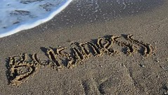 Inscription business on sand. The inscription is washed away by a sea wave.Shooting on the beach. (daria.boteva) Tags: abstract background beach brown business carved character coast communication computer concept conceptual design draw drawing english font grain grunge hand handdrawn handwriting idea image information inscription internet language message natural nature ocean sand sandy scratched sea seashore seaside shopping shore style summer text texture textured typescript wave word world write