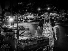 Bangkok Fast Food (Laith Stevens Photography) Tags: street food stall bangkok thailand blackandwhite bw night man cook satay action movement olympus olympusinspired olympusomd olympusau olympusaustralia olympusuk goneawol getolympus 17mmf28 omdem1 hungry ngc