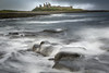 Breaking waves at Dunstanburgh (Uillihans Dias) Tags: dunstanburghcastle breakingwave waves seascape architecture uk britain england rocks historical history