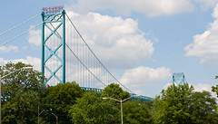 Bridge rising above the trees! (J.R. Rondeau) Tags: rondeau windsor ontario clouds bridge ambassadorbridge green canoneos tamron2875 photoshopelements10