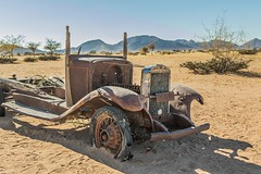 Bare Bones (gecko47) Tags: vehicle truck dilapidated wreck rust desert sand namibia solitaire blowntyres hulk carcass landscape