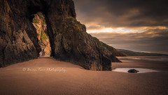 The Eye Of The Needle (.Brian Kerr Photography.) Tags: dumfriesandgalloway sandyhills scotland needleseye beach sunrise arch naturalarch briankerrphotography briankerrphoto scottishlandscapes scottish scotspirit visitscotland scottishlandscape landscape outdoor outdoorphotography opoty nature naturallandscape natural sony a7rii fe2470mmf28gm formatthitech sky clouds weather shore reflections sand sandybeach rock cliff