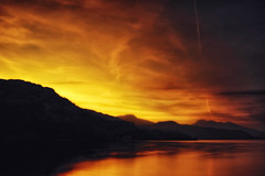 Loch Lomond Shores (HSS Version) (der_peste) Tags: hss sliderssunday postprocessing water mountains lake loch scotland lochlomond trossachs sky burningsky clouds silhouettes sunset sundown