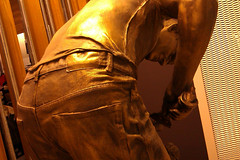 IMAG0333 [ps] - Shearer's Seams (Anyhoo) Tags: anyhoo photobyanyhoo australia melbourne vic victoria airport art sculpture statue shearer man male figure metal phonecam airportart publicart arse seat backside bottom