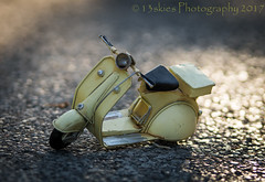A Kiss (13skies) Tags: scooter depthoffield yellow road pavement sunlight daytime daylight wheels play fun riding travel kisses love meaning sonyalpha99