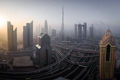 downtown (nils stefan püschel) Tags: cityscape view skyscraper sunrise uae dubai morning mist fog haze light sun street road build
