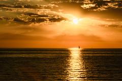 Amanecer frente al mar - Sunrise waterfront (i.puebla) Tags: amanecer españa exterior girona llançà mar salidasol sol spain cataluña catalonia sunrise airelibre sun sea cielo sky nubes clouds velero sailboat reflections reflection nikon d7200 naturaleza nature naranja orange