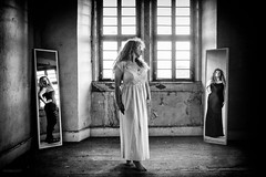 difficult decision (DirkBee) Tags: woman indoor mirror digiart composing portrait dress available light blackandwhite bestportraitsaoi
