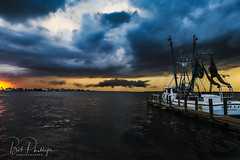 Matlacha Stormy Weather (tropicdiver) Tags: florida matlacha boat clouds dock drawbridge gulfofmexico pineislandsound stormyweather sunset