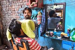 The barber of Delhi (bananacake1000) Tags: india delhi streetphotography streetportrait candid photojournalism nikon barber urban
