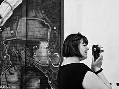 DSCN9740 (Akbar Simonse) Tags: rotterdam holland netherlands nederland streetphotography streetshot straatfotografie straatfoto straat street urban stad zwartwit bw blancoynegro bn monochrome people candid woman camera photographer akbarsimonse amsterdam graffiti juxtaposition