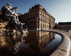 Fountain of Heritage (Thomas Listl) Tags: thomaslistl color sunlight october light water reflection mirror fountain frankoniabrunnen würzburg riemenschneider statue residenzwürzburg residence blue sky architecture 14mm ultrawideangle 4x5 vsco