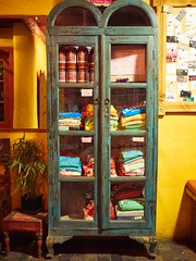 Merchandise armoire at La Choza (marcocarag) Tags: restaurant furniture newmexico santafe