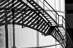 Staircase Shadows (Leipzig_trifft_Wien) Tags: staircase ladder shadow light sunlight tank black white bw monochrome architecture city urban technical excape lines pattern structure curve wien vienna austria