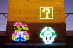Wanna play? (II) (Le2 - www.le2.es) Tags: lightpainting lights colours entertainment photography longexposure creativity mario bros children videogames city urban nightshot wall
