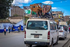 In Latin America you can fit so much on the roof of a vehicle.  In this case two harps.
