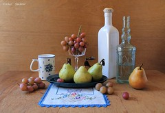 Seasonal Challenges (Esther Spektor - Thanks for 12+millions views..) Tags: stilllife naturemorte bodegon naturezamorta stilleben naturamorta composition creativephotography artisticphoto arrangement tabletop seasonal fruit pear grape cluster bottle dish goblet cup napkin embroidery creamics glass pattern ambientlight white brue green yellow brown estherspektor canon