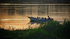 A New Round ... A New Beginning   (Fishermen At Work) (Hazem Hafez) Tags: fishermen boat rowing nile sunset fishing water river